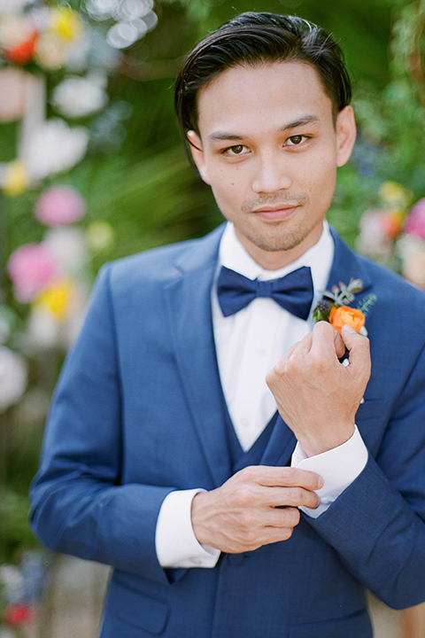 Caravan-outpost-outdoor-wedding-shoot-groom-blue-suit-close-up