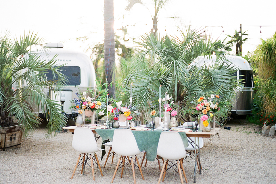 Caravan-outpost-outdoor-wedding-shoot-table-set-up-with-chairs