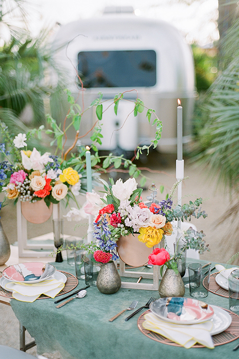 Caravan-outpost-outdoor-wedding-shoot-table-set-up-with-flowers