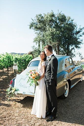 Cielo-Farms-Wedding-Couple-Leaning-On-Car