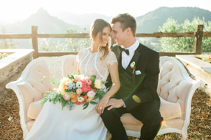 Cielo-Farms-Wedding-Couple-Sitting-on-Couch