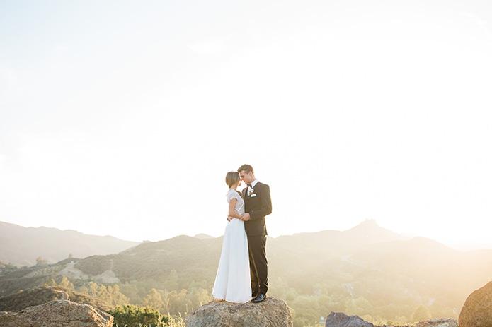 Cielo-Farms-Wedding-Couple-Standing-on-Rock
