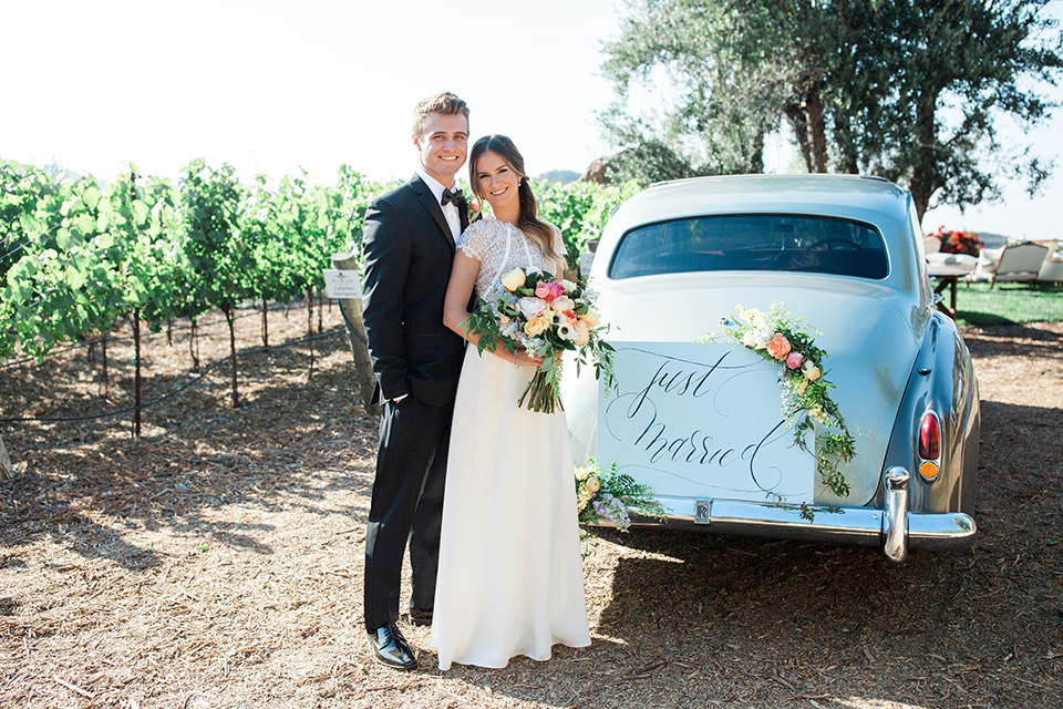 Cielo-farms-wedding-bride-and-groom-standing-by-car