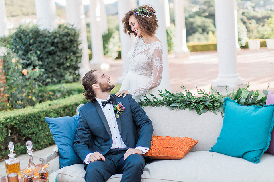 Colorful-bohemian-wedding-shoot-bride-and-groom-by-couch