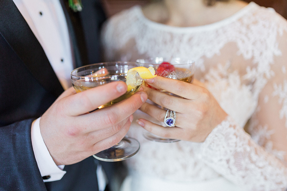 Colorful-bohemian-wedding-shoot-bride-and-groom-holding-drinks