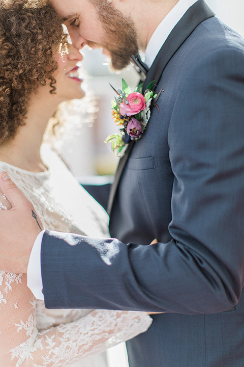 Colorful-bohemian-wedding-shoot-bride-and-groom-hugging-close-up