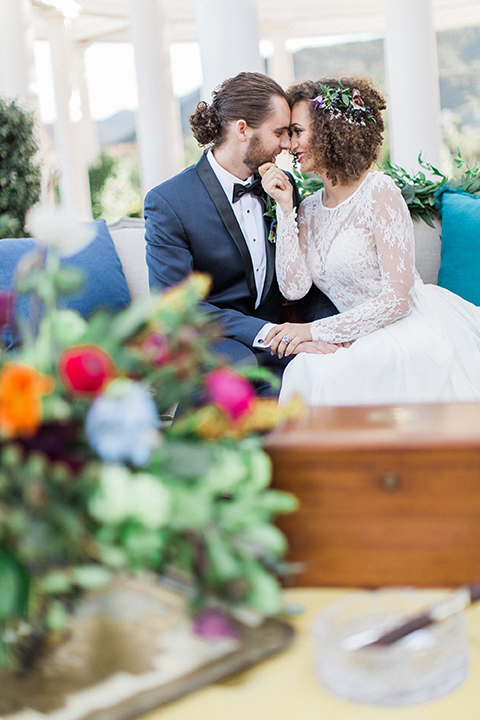 Colorful-bohemian-wedding-shoot-bride-and-groom-sitting-and-hugging