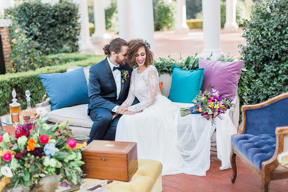 Colorful-bohemian-wedding-shoot-bride-and-groom-sitting