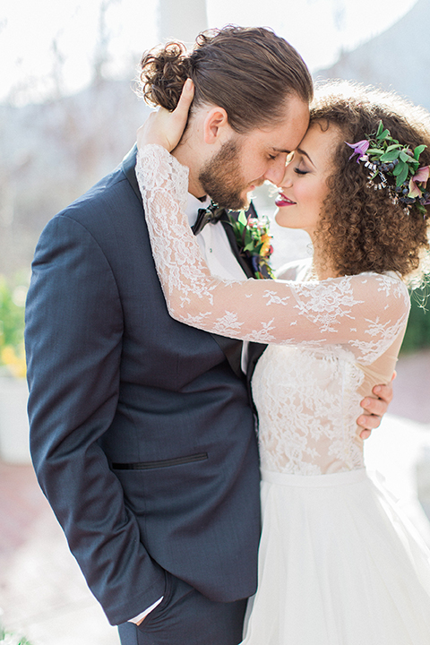 Colorful-bohemian-wedding-shoot-bride-and-groom-standing-and-hugging