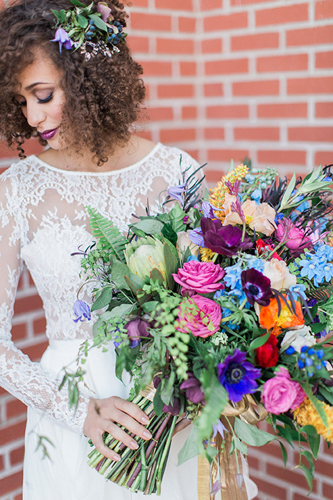 Colorful-bohemian-wedding-shoot-bride-holding-bouquet