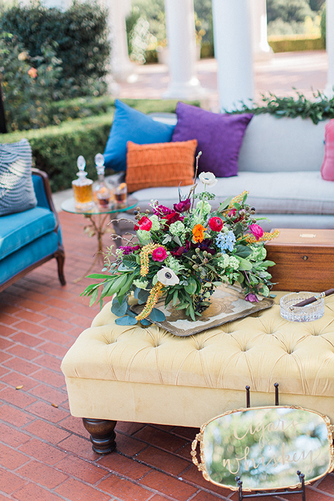Colorful-bohemian-wedding-shoot-table-and-couch-area
