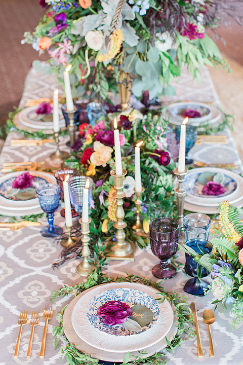 Colorful-bohemian-wedding-shoot-table-place-setting-and-candles