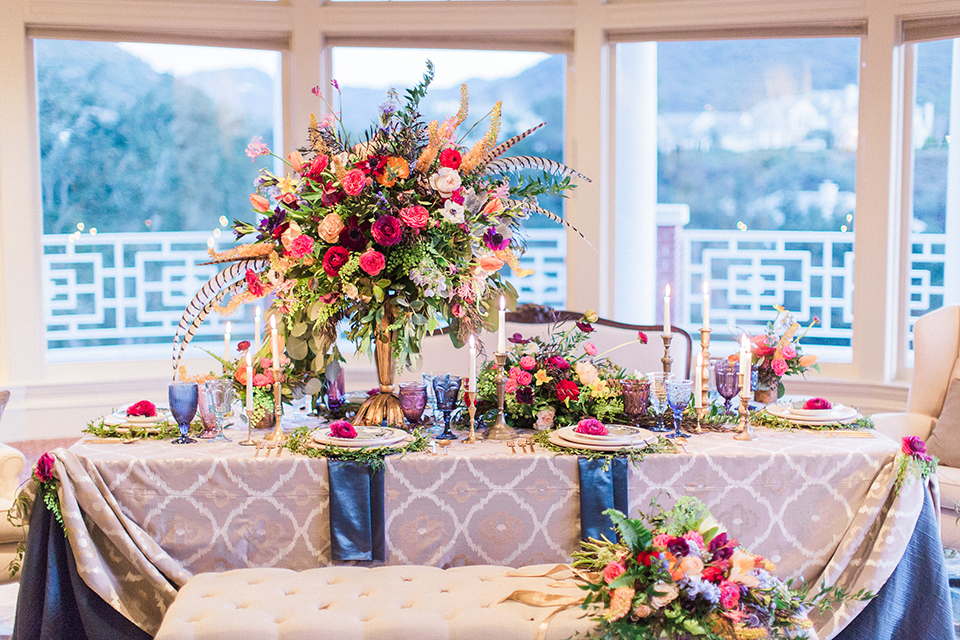 Colorful-bohemian-wedding-shoot-table-with-bright-flowers