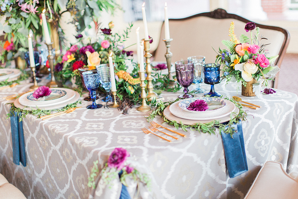 Colorful-bohemian-wedding-shoot-table-with-candles