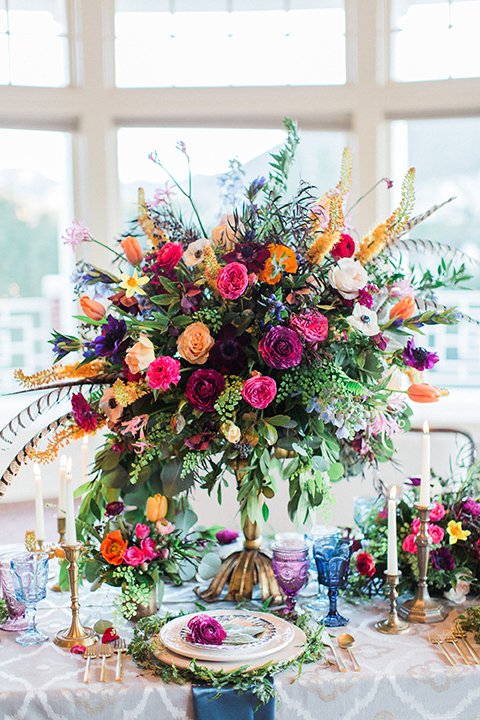 Colorful-bohemian-wedding-shoot-table-with-flowers