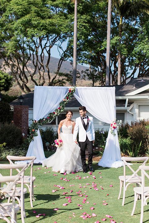 Santa-barbara-outdoor-wedding-bride-and-groom-ceremony-holding-hands-smiling