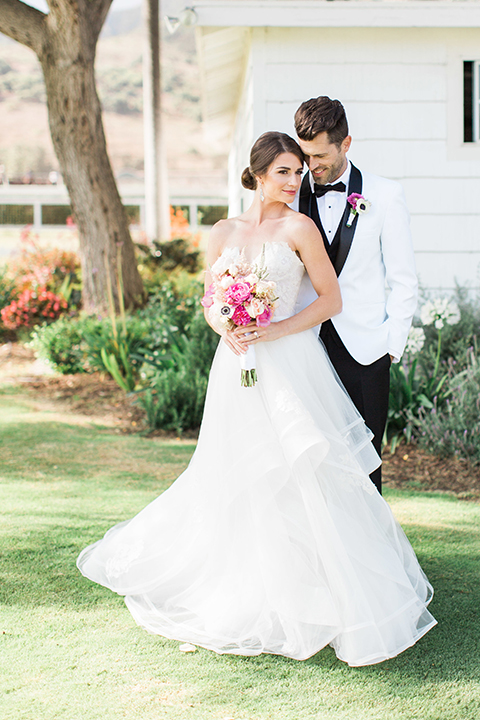 Santa-barbara-outdoor-wedding-bride-and-groom-hugging-and-smiling