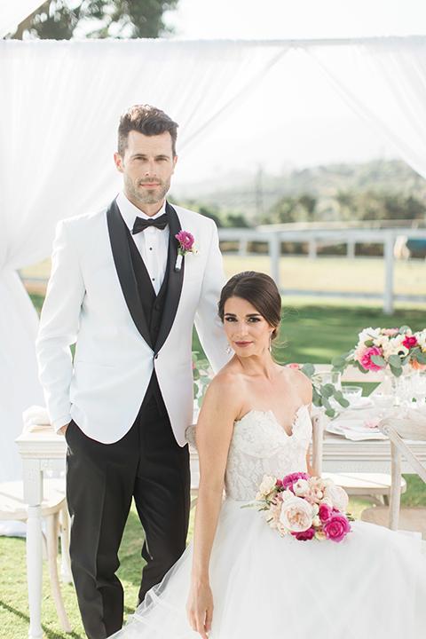 Santa-barbara-outdoor-wedding-bride-and-groom-sitting-at-table