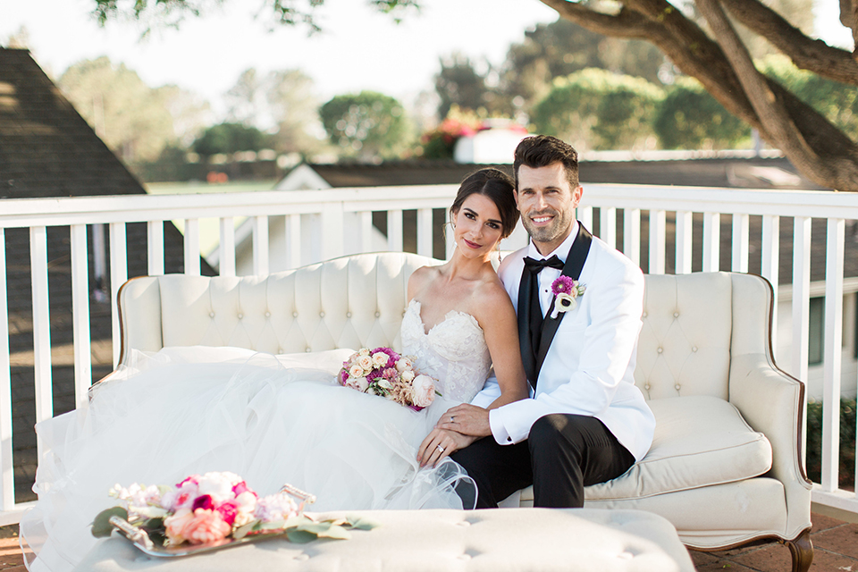 Santa-barbara-outdoor-wedding-bride-and-groom-sitting-smiling