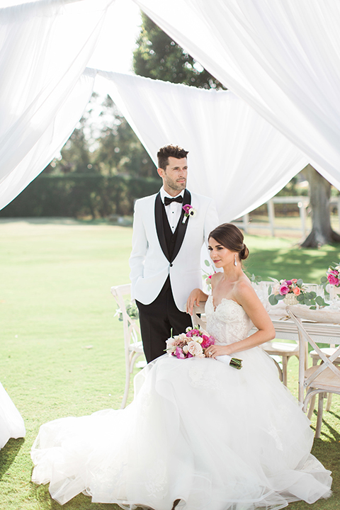 Santa-barbara-outdoor-wedding-bride-and-groom-sitting