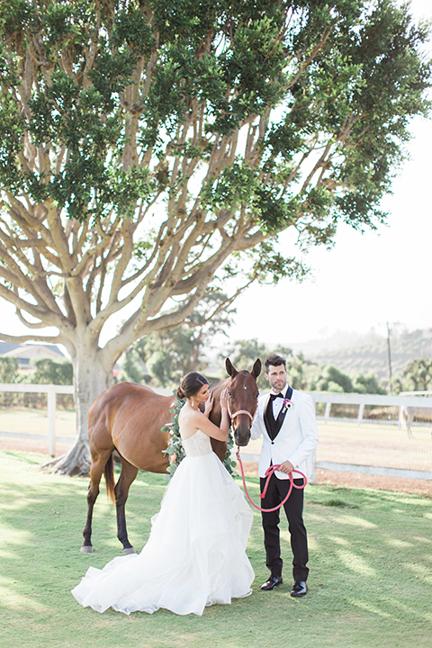 Santa-barbara-outdoor-wedding-bride-and-groom-standing-by-horse-far-away