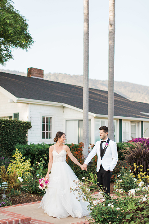 Santa-barbara-outdoor-wedding-bride-and-groom-standing-holding-hands
