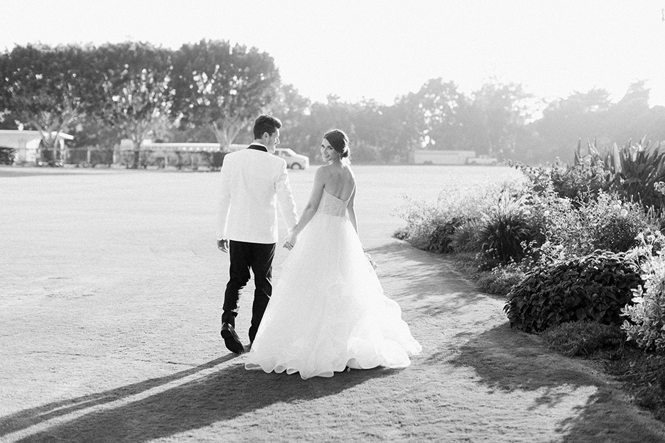 Santa-barbara-outdoor-wedding-bride-and-groom-walking-smiling