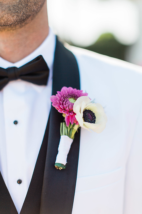 Santa-barbara-outdoor-wedding-groom-white-tuxedo-close-up-boutonniere