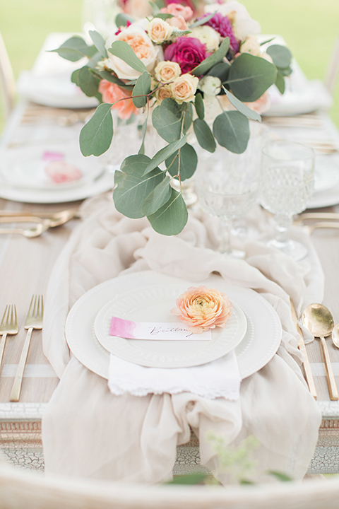 Santa-barbara-outdoor-wedding-table-set-up-with-flowers-and-place-settings