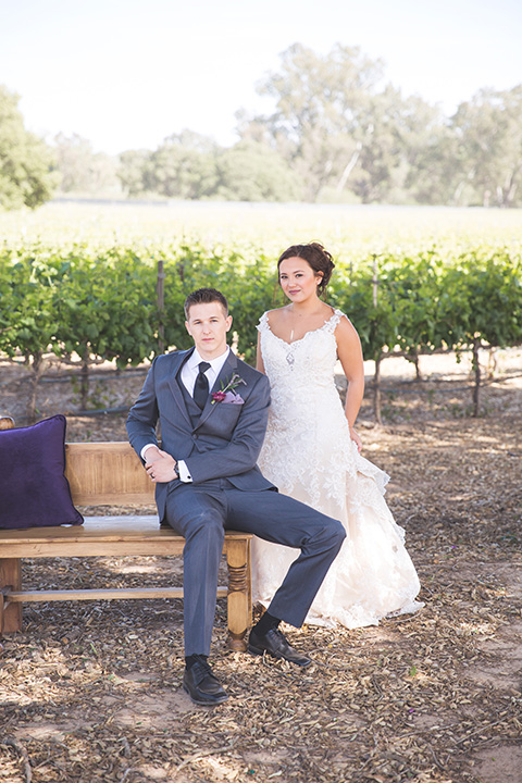 Santa-barbara-wedding-shoot-at-cottonwood-canyon-winery-bride-and-groom-hugging-and-sitting-close-up