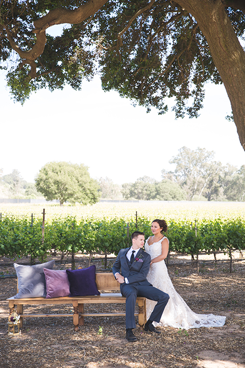 Santa-barbara-wedding-shoot-at-cottonwood-canyon-winery-bride-and-groom-hugging-and-sitting