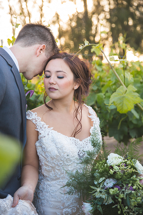 Santa-barbara-wedding-shoot-at-cottonwood-canyon-winery-bride-and-groom-standing-and-hugging