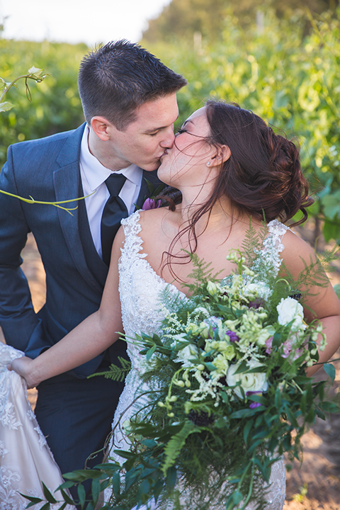 Santa-barbara-wedding-shoot-at-cottonwood-canyon-winery-bride-and-groom-standing-and-kissing