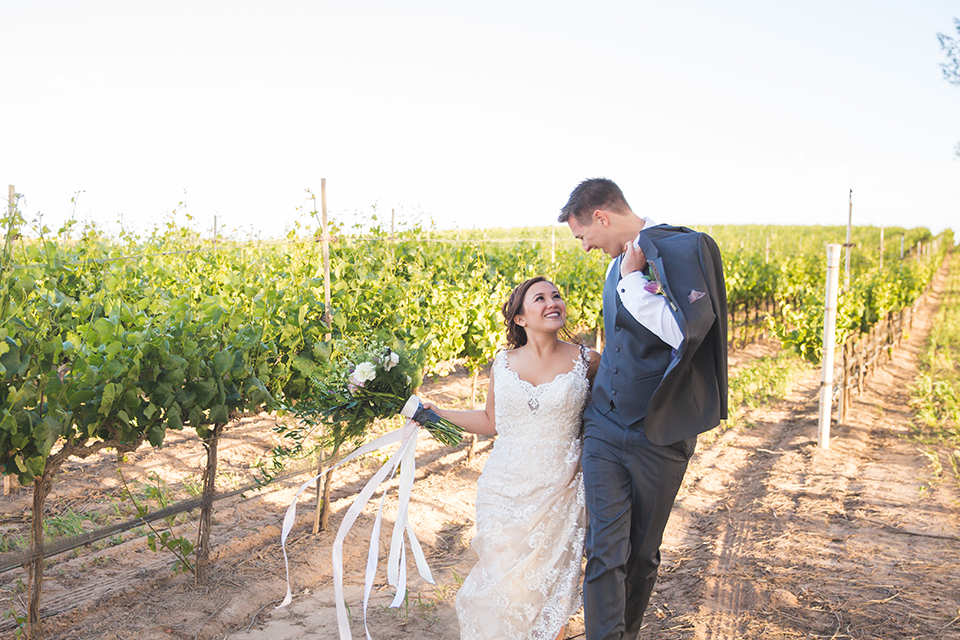 Santa-barbara-wedding-shoot-at-cottonwood-canyon-winery-bride-and-groom-standing-and-laughing