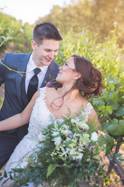 Santa-barbara-wedding-shoot-at-cottonwood-canyon-winery-bride-and-groom-standing-and-smiling