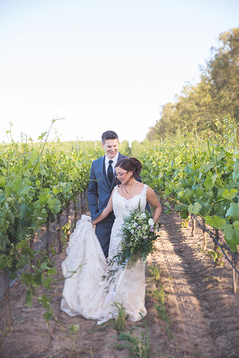 Santa-barbara-wedding-shoot-at-cottonwood-canyon-winery-bride-and-groom-standing-and-walking