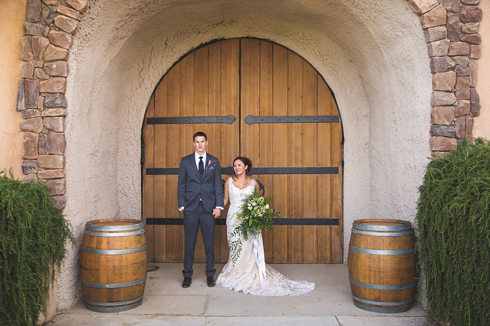 Santa-barbara-wedding-shoot-at-cottonwood-canyon-winery-bride-and-groom-standing-holding-hands