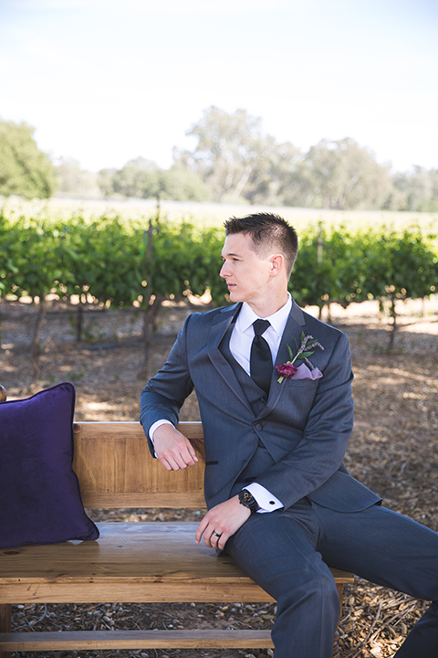 Santa-barbara-wedding-shoot-at-cottonwood-canyon-winery-groom-sitting-close-up