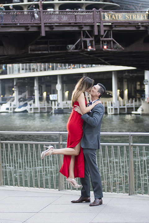 Chicago-outdoor-engagement-shoot-bride-and-groom-lifting-bride-and-kissing
