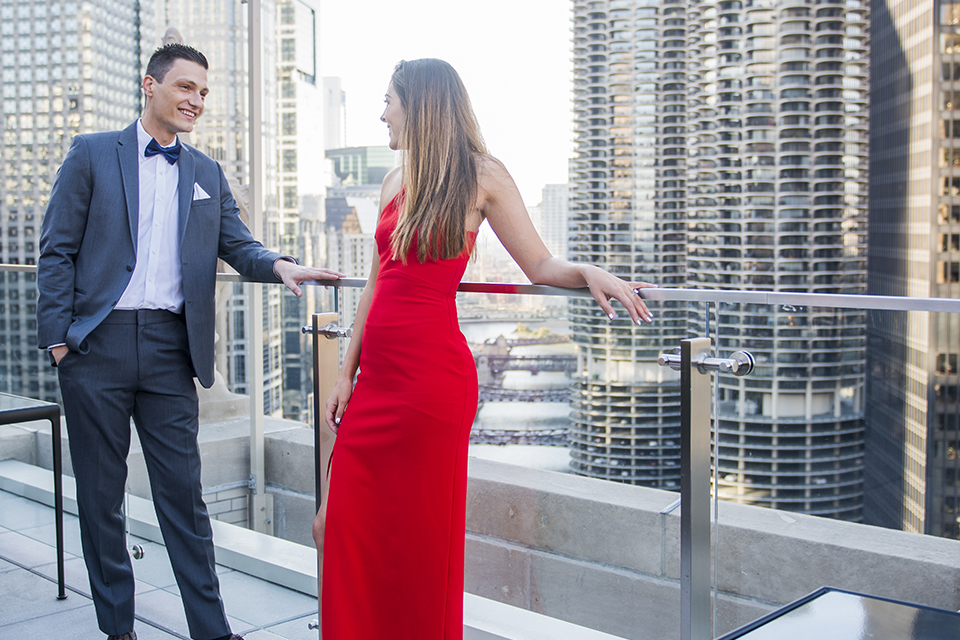 Chicago-outdoor-engagement-shoot-bride-and-groom-standing-on-balcony