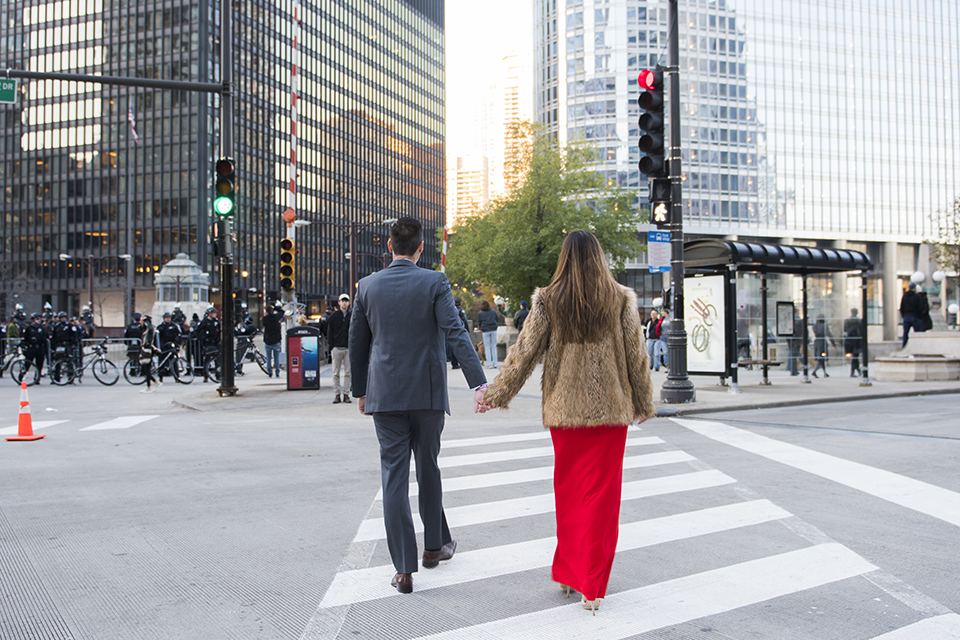Chicago-outdoor-engagement-shoot-bride-and-groom-walking-across-street