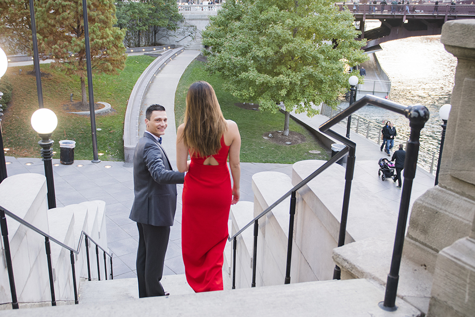 Chicago-outdoor-engagement-shoot-bride-and-groom-walking-down-stairs