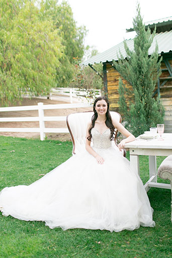 FairyTale-Wedding-Bride-Sitting-At-Table