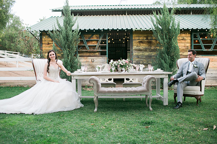 FairyTale-Wedding-Couple-Sitting-At-Table