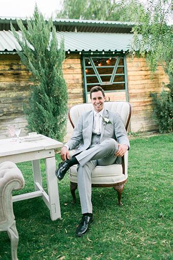 FairyTale-Wedding-Groom-Sitting-At-Table
