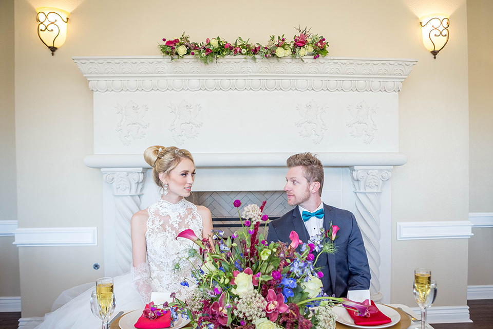 Fit-for-royalty-wedding-shoot-bride-and-groom-sitting-at-table