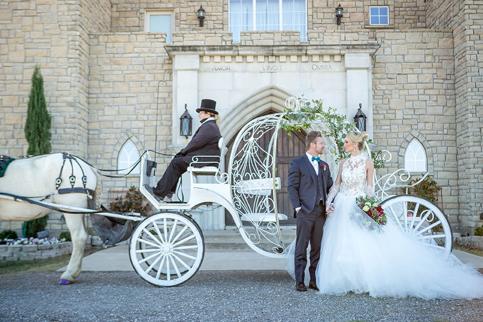 Fit-for-royalty-wedding-shoot-bride-and-groom-standing-by-carriage