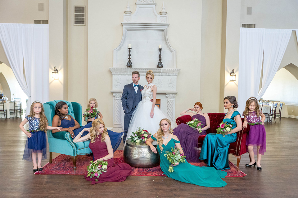 Fit-for-royalty-wedding-shoot-bride-and-groom-with-wedding-party-sitting