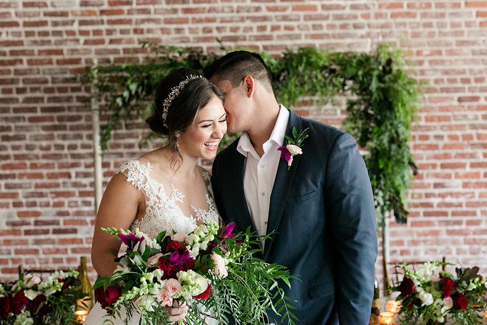 San-juan-capistrano-wedding-shoot-at-franciscan-gardens-bride-and-groom-hugging-kissing