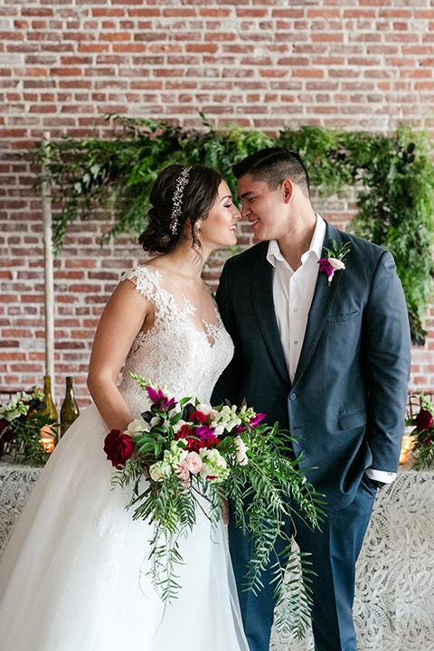 San-juan-capistrano-wedding-shoot-at-franciscan-gardens-bride-and-groom-hugging